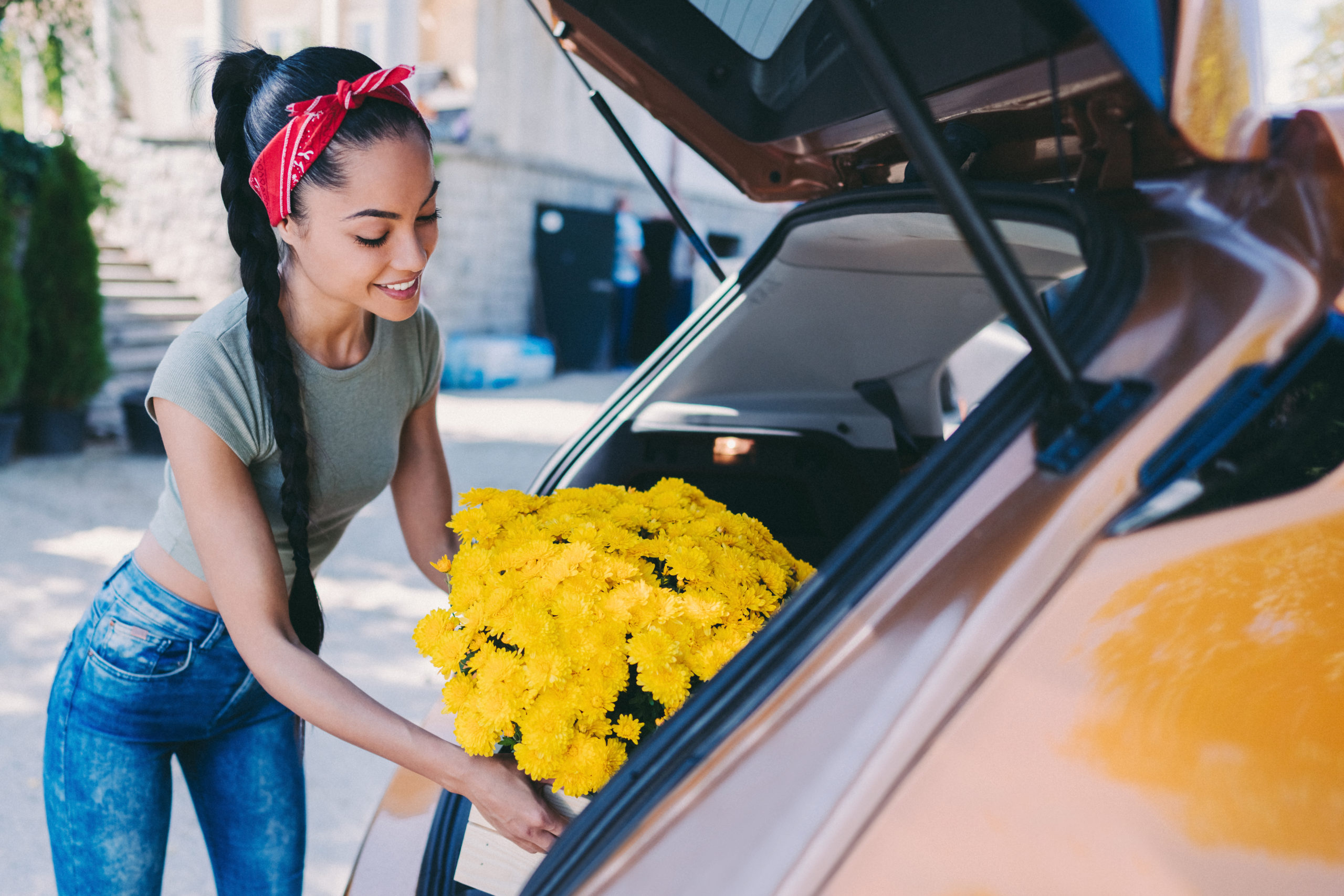 A young florist packing her car for a delivery   florist near Clarksburg