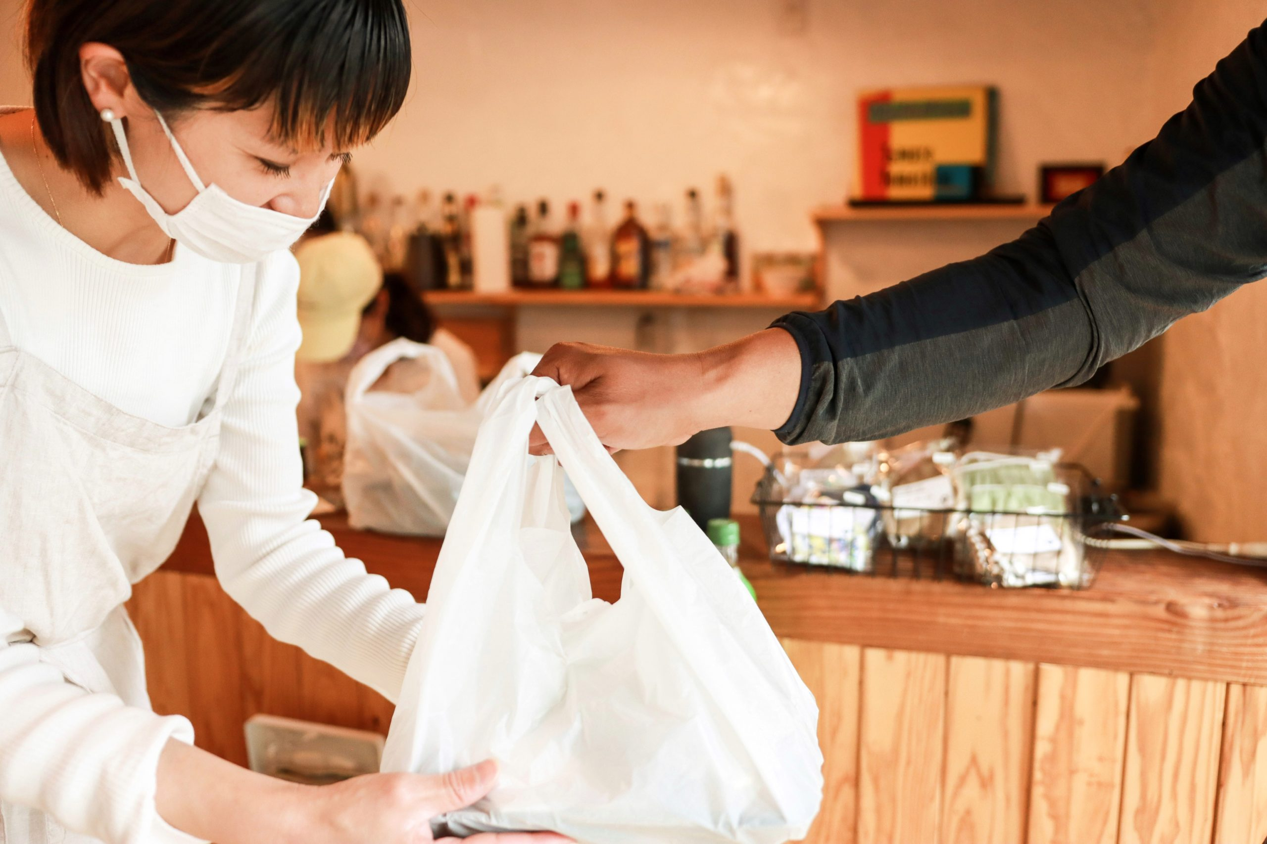 A man receiving his takeout order from a Japanese restaurant   Japanese food in Clarksburg